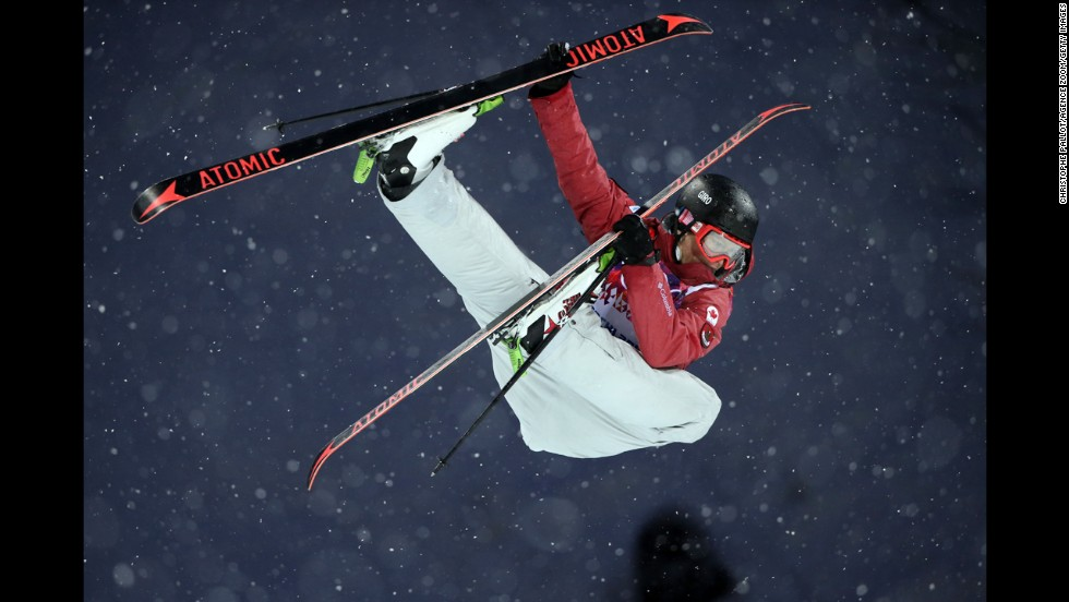 Canadian skier Mike Riddle competes in the men's halfpipe.