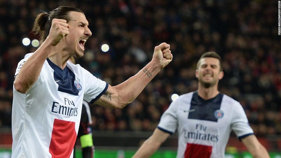 Zatan Ibrahimovic celebrates one of his two goals as PSG blitz Bayer Leverkusen in Germany.