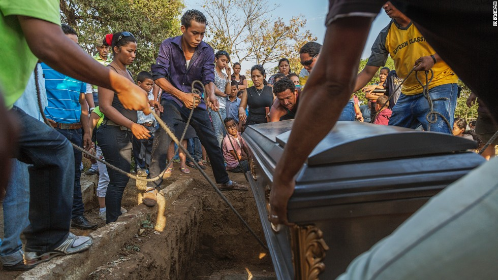 "The casket is lowered at a funeral for a 49-year-old sugar cane worker in Chichigalpa, Nicaragua. Mortality rates from chronic kidney disease in the La Isla community are so high that it is now called La Isla de Viudas, or ""The Island of Widows."""
