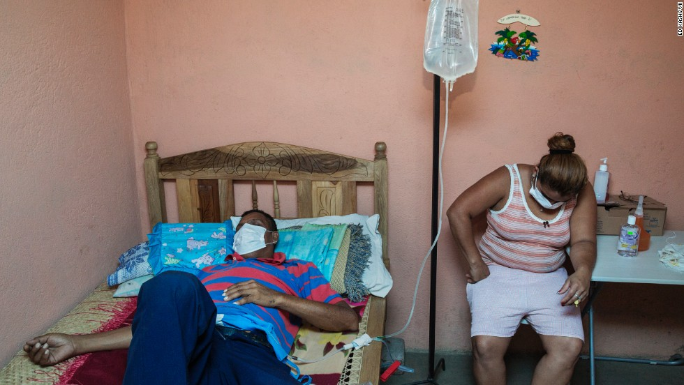 A man who worked in the sugar cane fields for decades receives dialysis at home with his daughter. He and his 24-year-old son, who worked in the fields for just five years, are both suffering from kidney disease. The names of the victims and their families are being withheld due to the ongoing tension about the prevalence of the disease.