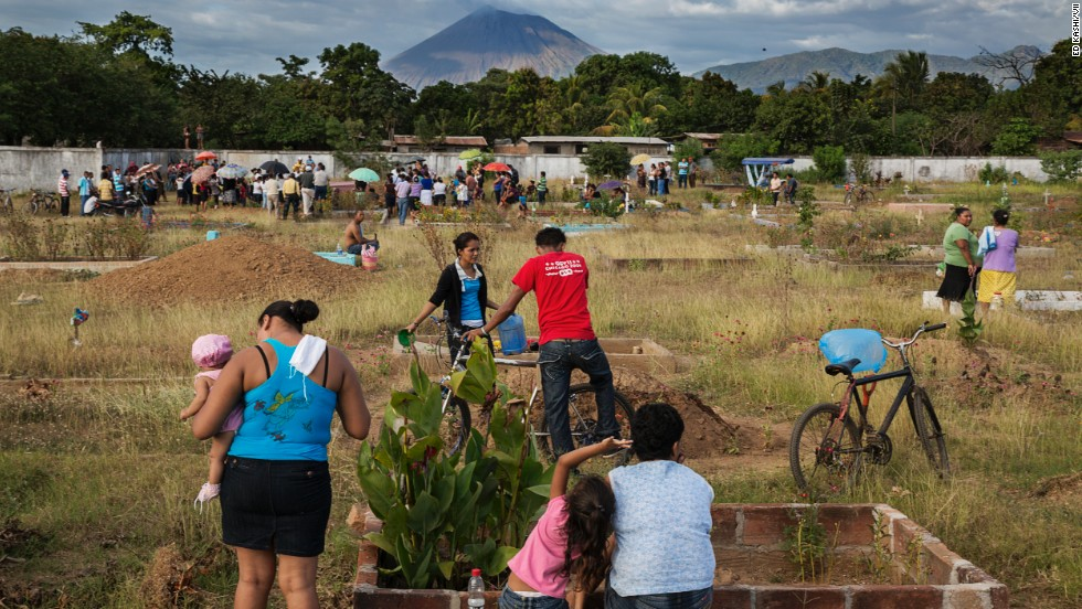 People gather for the funerals of two former sugarcane workers. From 2002 to 2012, 75% of deaths for men ages 35 to 55 in Chichigalpa have been attributed to chronic kidney disease, according to La Isla Foundation.
