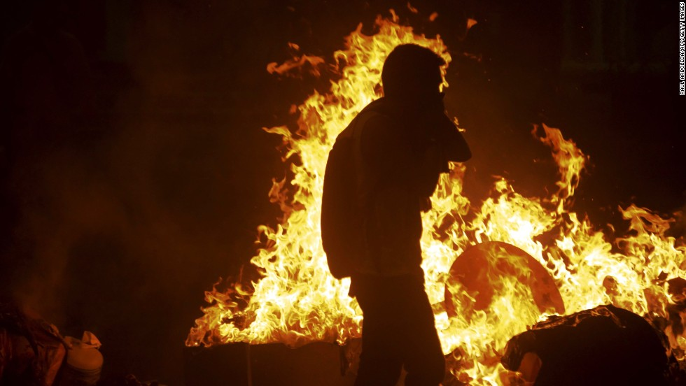 Lopez supporters light fires in the streets of Caracas on February 18.
