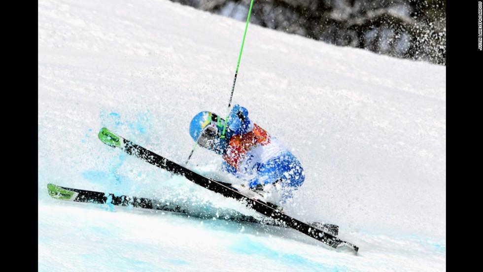 Sebastiano Gastaldi of Argentina crashes during his first giant slalom run.