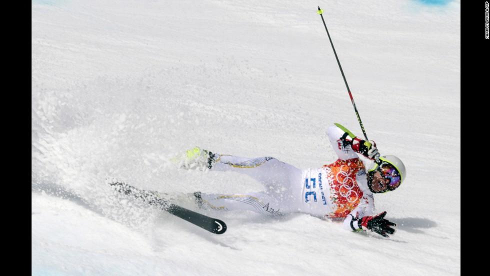 Andorra's Joan Verdu Sanchez crashes in the first run of the men's giant slalom.