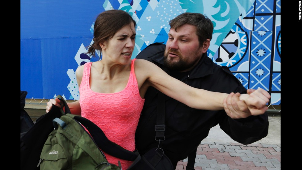 Tolokonnikova is pulled away after the protest performance.