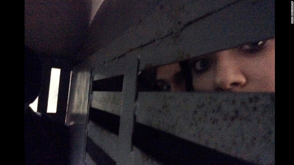 This photo provided by Alyokhina, was taken in the back of a police detention vehicle after her arrest on February 18. She and other band members tweeted the news about their detention from their cell phones, with Tolokonnikova posting photos of what she said was the vehicle that was taking her to a police station.
