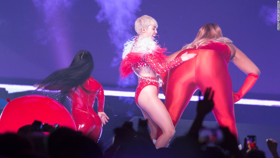 "In April 2014, Cyrus was doing her thing on stage when a fight broke out between fans at a show in Detroit. Cyrus <a href=""http://www.torontosun.com/2014/04/14/miley-cyrus-films-fight-between-fans-at-concert"" target=""_blank"">reportedly took time out to record the two women and post the video to her Instagram, where she could be heard yelling ""Catfight!""</a>"