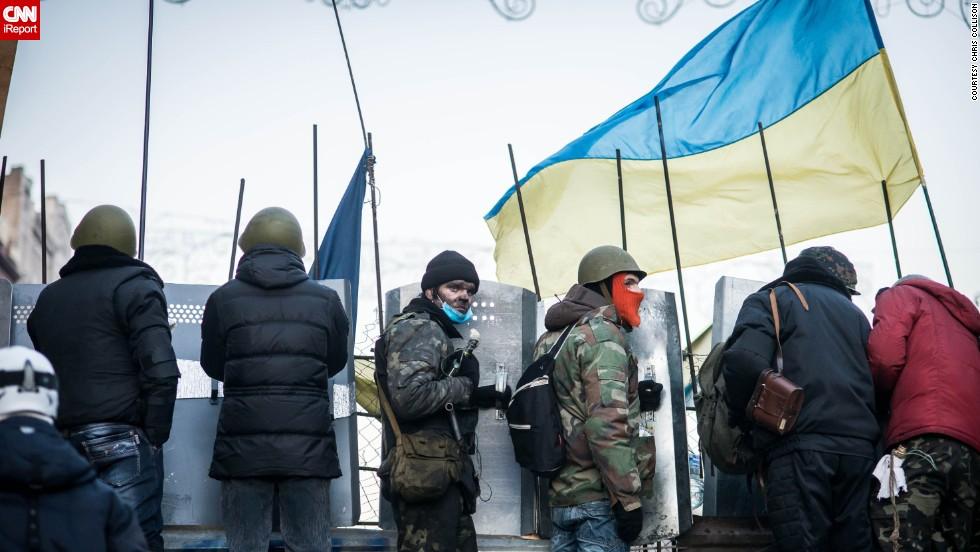 Protesters line up along barricades as Berkut police surround Maidan Nezalezhnosti, Kiev's central square, on February 18.