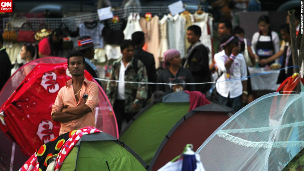 "Protesters stand near their tents in Bangkok, where they have been camping out since November 2013. ""The atmosphere was peaceful ... though some tension was to be read from the protestors' faces,"" Kowalska said."