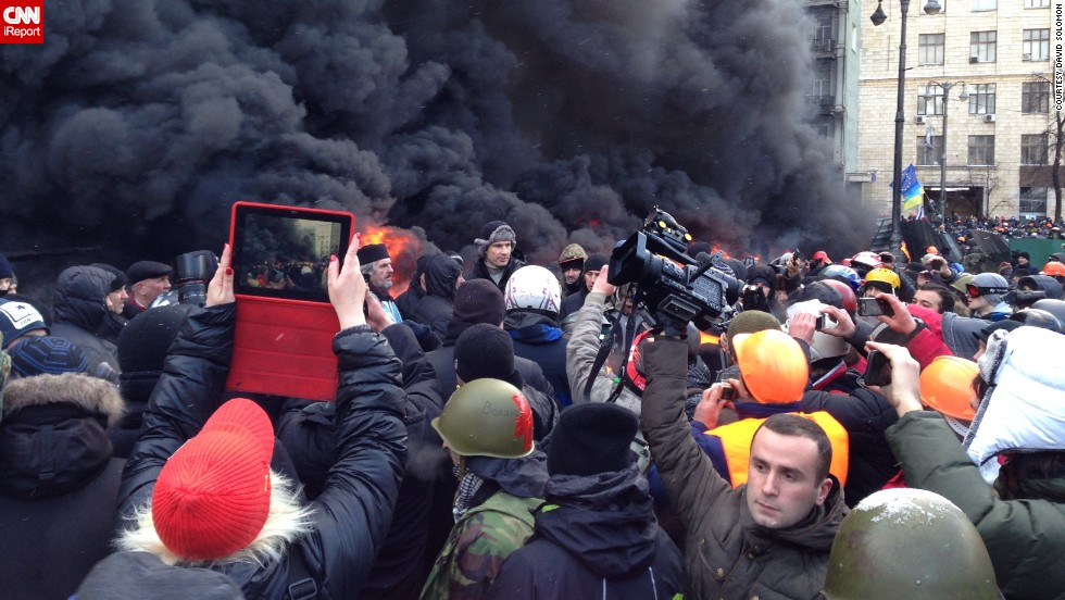 "<a href=""http://ireport.cnn.com/docs/DOC-1077690"">David Solomon</a>, who was visiting Ukraine, spotted heavyweight boxer Vitali Klitschko (shown in the center wearing a fur hat) at a January 23 protest in Kiev. ""This high-profile person came to this seemingly menacing environment to show his supporters that he does indeed stand by them, and he literally did."""
