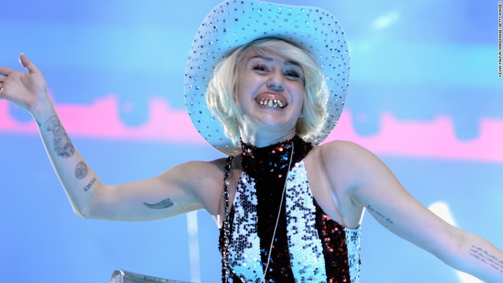 Cyrus performs with false teeth during her Bangerz Tour at Rogers Arena on February 14, 2014 in Vancouver, Canada.