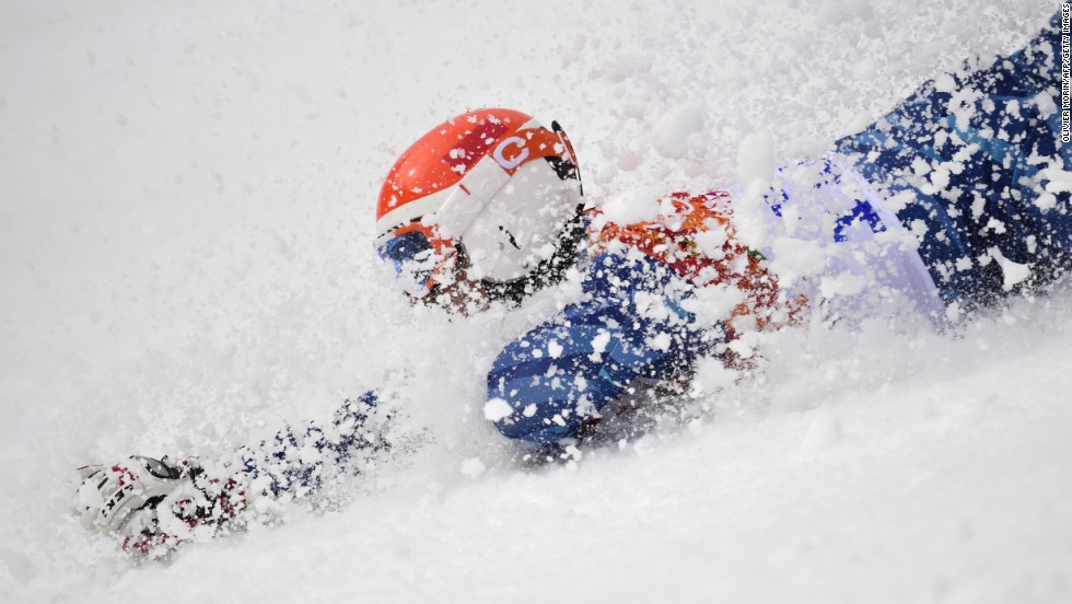 Venezuelan skier Jose Antonio Pardo Andretta crashes during his first run in the giant slalom Wednesday, February 19.