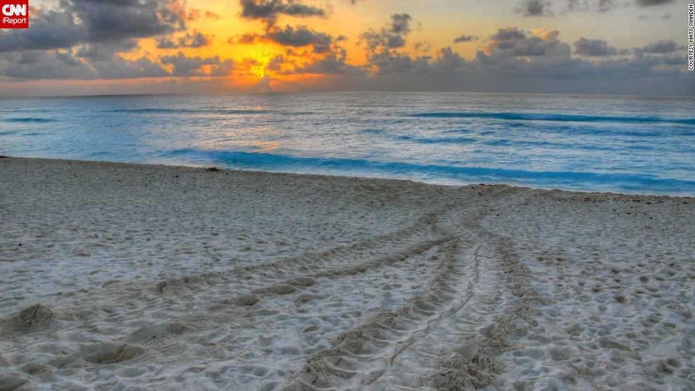 "<a href=""http://ireport.cnn.com/docs/DOC-1078686"">Matt Swinden</a> captured turtle tracks in the sand at sunrise on a Cancun beach."
