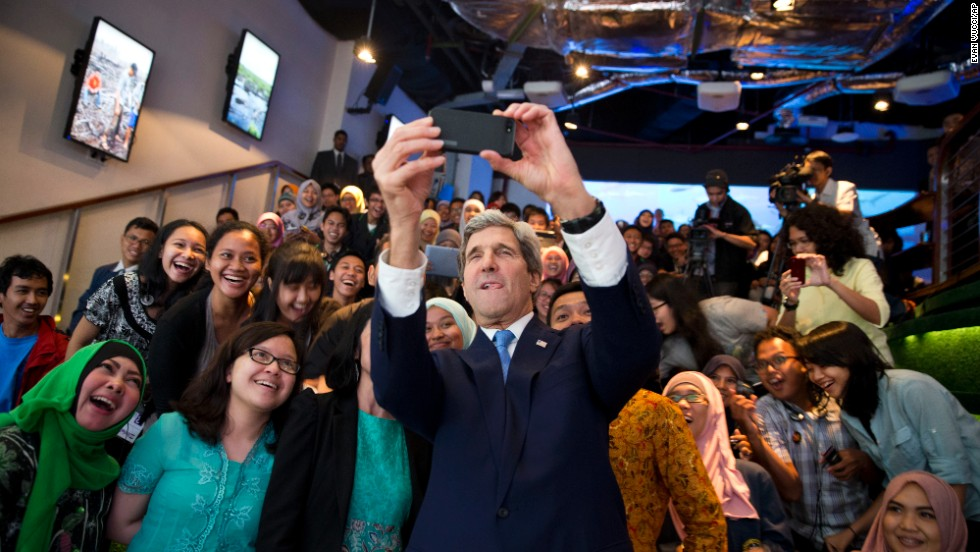 "Secretary of State John Kerry takes a selfie with a group of students before delivering <a href=""http://www.cnn.com/2014/02/16/politics/kerry-climate/index.html"">a speech on climate change</a> in Jakarta, Indonesia, on February 16."