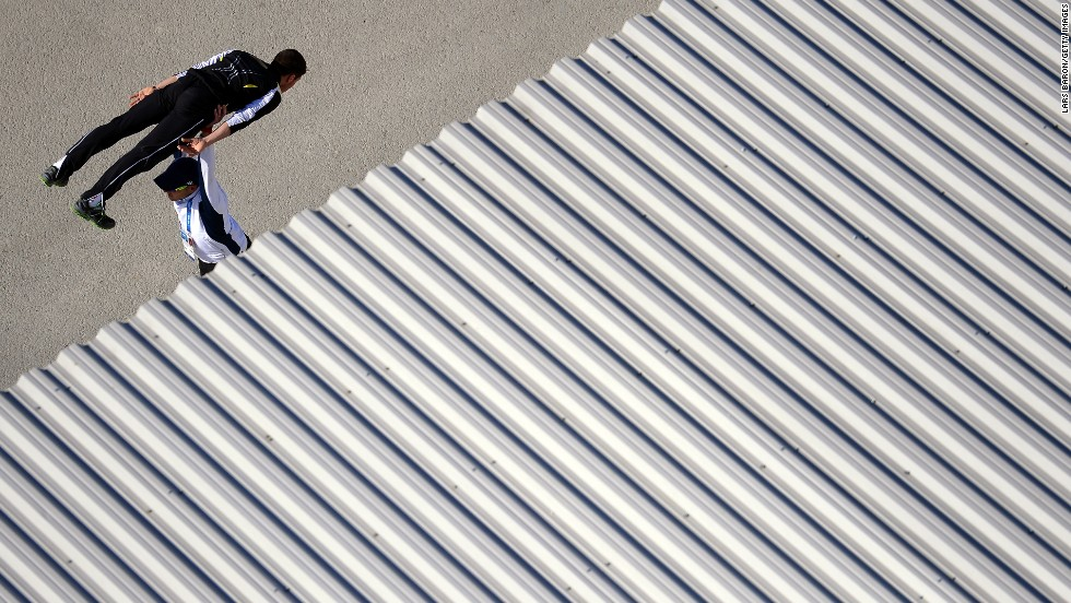 "An Olympic ski jumper warms up with his coach before <a href=""http://edition.cnn.com/2014/02/08/worldsport/gallery/visions-of-sochi/index.html"">competing in Sochi</a> on February 15."