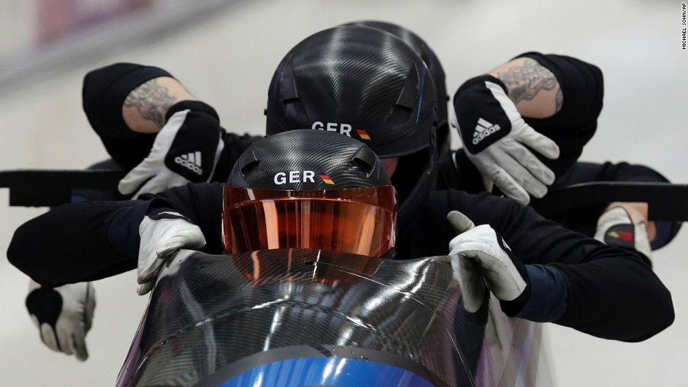 The Germany-1 bobsled team, piloted by Maximilian Arndt, starts a training run February 20.