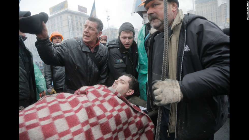An injured protester is evacuated from Independence Square on February 20.
