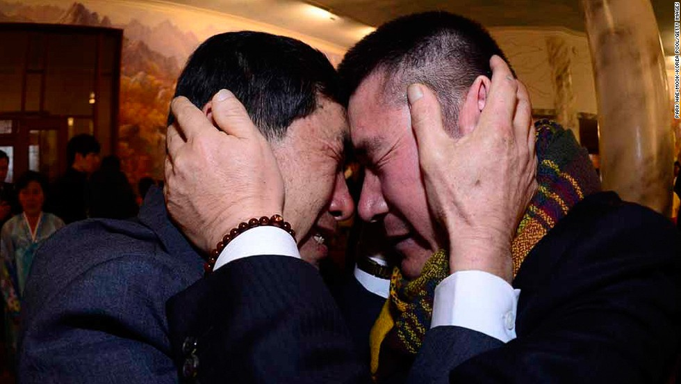 "FEBRUARY 20 - MOUNT KUMGANG, NORTH KOREA: South Korean Park Yang-Gon (left) embraces his North Korean brother Park Yang-Soo during a family reunion after being separated for 60 years. The event, which allows <a href=""http://cnn.com/2014/02/20/world/asia/koreas-reunion/index.html?hpt=hp_c3"">reunions of family members separated by the Korean War</a>, is a result of a recent agreement between North and South Korea that had been suspended since 2010."