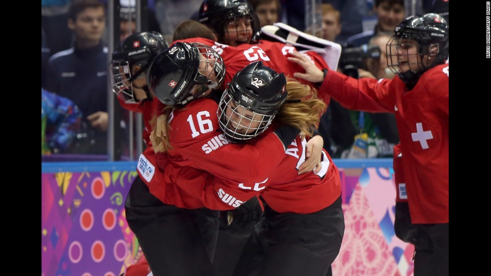 Members of the Swiss women's hockey team celebrate after defeating Sweden for the bronze medal on February 20.