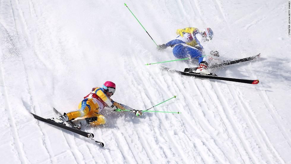 Victor Oehling Norberg of Sweden, left, and Egor Korotkov of Russia crash during the quarterfinals of the men's ski cross on February 20.