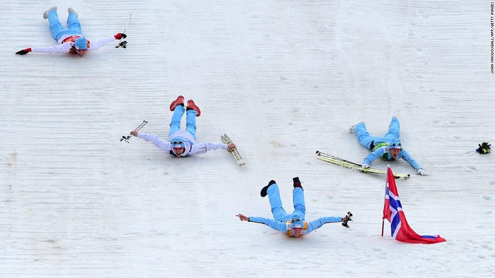 The members of Norway's Nordic combined team -- Magnus Hovdal Moan, Magnus Krog, Haavard Klemetsen and Joergen Graabak -- celebrate after winning the gold medal February 20.