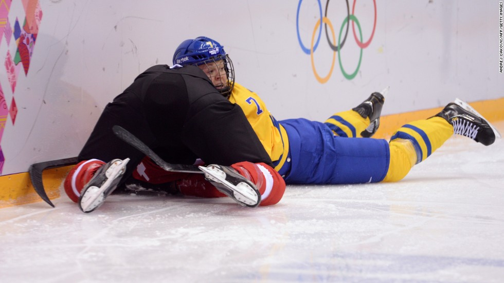 Sweden's Johanna Olofsson fights for the puck during the women's hockey game against Switzerland.