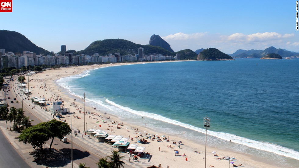 "Sugarloaf Mountain in the distance ""adds a beautiful backdrop for laying out on the sand and enjoying the Brazil sunshine"" at Copacabana Beach in Rio de Janeiro, said <a href=""http://ireport.cnn.com/docs/DOC-1083063"">Keith Johnson</a>, who visited in May."