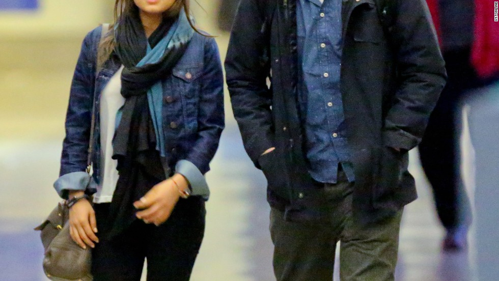 Mila Kunis and Ashton Kutcher try to stay low-key while at LAX on February 19.
