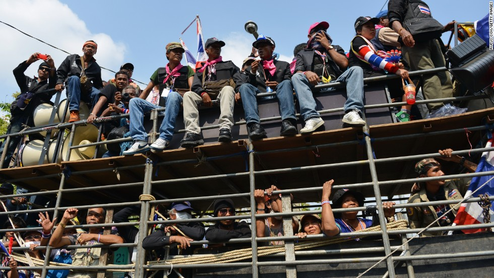 Protesters arrive at a rally outside a police headquarters in Bangkok on Friday, February 14.
