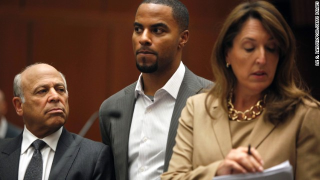 Former pro-footballer Darren Sharper, center, appears in court alongside his attorneys in Los Angeles on February 14.