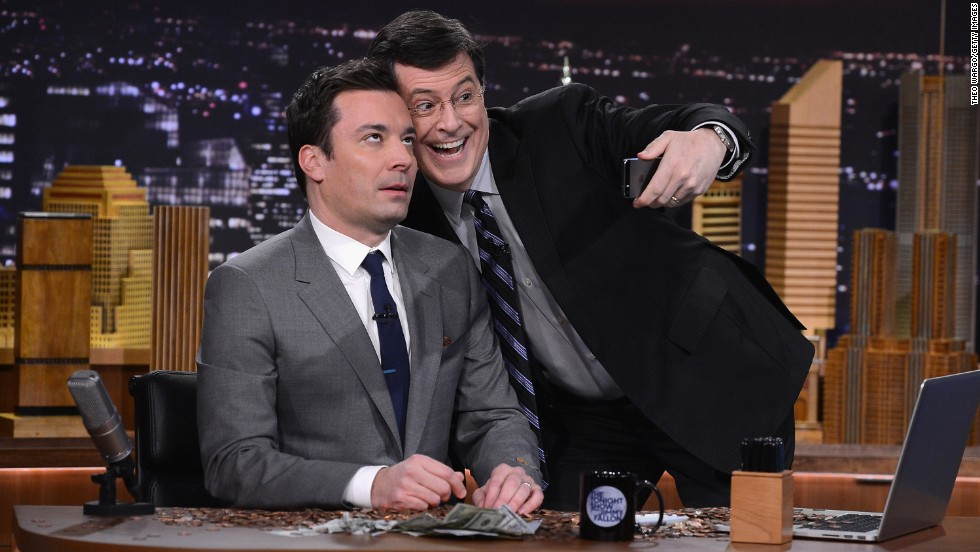 "Stephen Colbert takes a selfie with Jimmy Fallon during the debut episode of ""The Tonight Show Starring Jimmy Fallon"" on February 17. <a href=""http://www.cnn.com/2014/02/18/showbiz/tv/jimmy-fallon-tonight-show-debut/index.html"">Fallon is the latest</a> in a six-decade line of ""Tonight"" hosts."