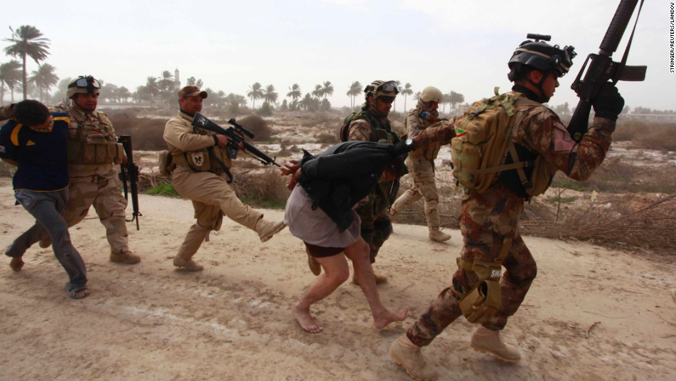 Iraqi security forces arrest suspected militants of the al Qaeda-linked Islamic State in Iraq and the Levant during clashes in Jurf al-Sakhar, Iraq, on February 15.