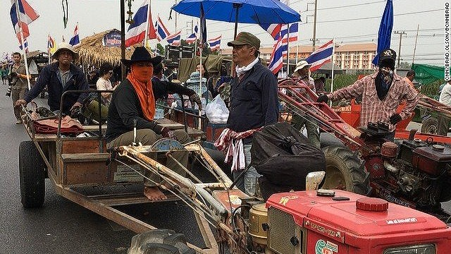Farmers ride tractors to Bangkok protests
