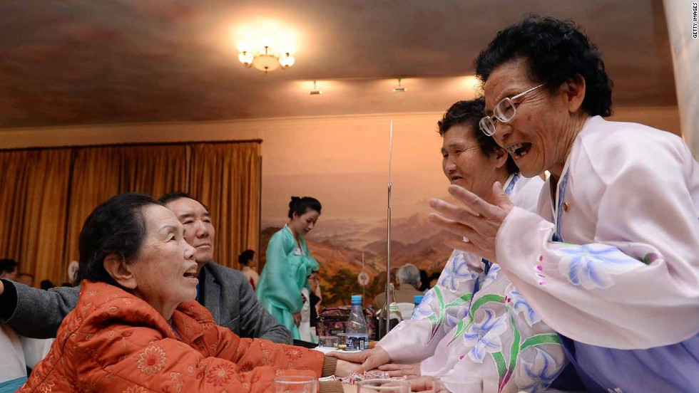 South Korean Lee Oh-Hwan (L), 85, meets with her North Korean sisters. The negotiations leading to the reunions were painstaking, reflecting the tensions between North and South Korean governments.
