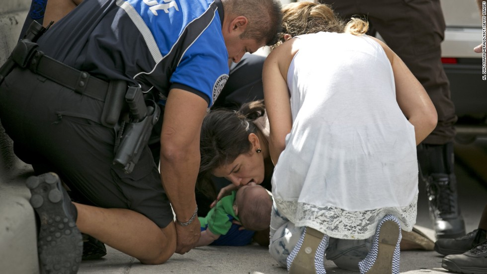 Pamela Rauseo performs CPR on her 5-month-old nephew, Sebastian de la Cruz, after pulling over on the side of a Miami highway on Thursday, February 20. She was stuck in traffic when the infant stopped breathing.