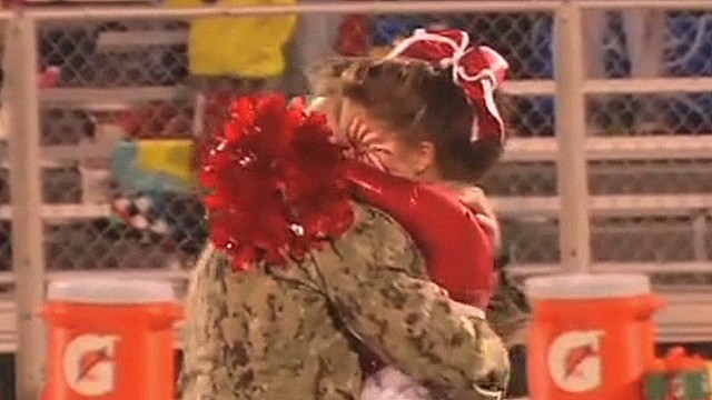 HLN soldier surprises cheerleader daughter_00003114.jpg