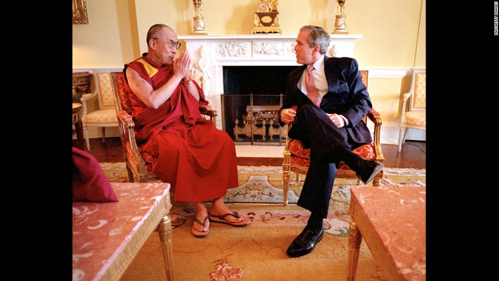 President George W. Bush meets with the Dalai Lama in the Oval Office in May 2001.