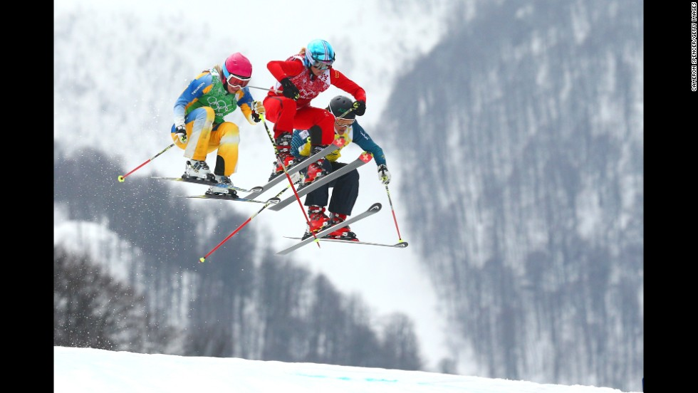 From left, Sandra Naeslund of Sweden, Jorinde Mueller of Switzerland and Jenny Owens of Australia compete in the women's ski cross on February 21.