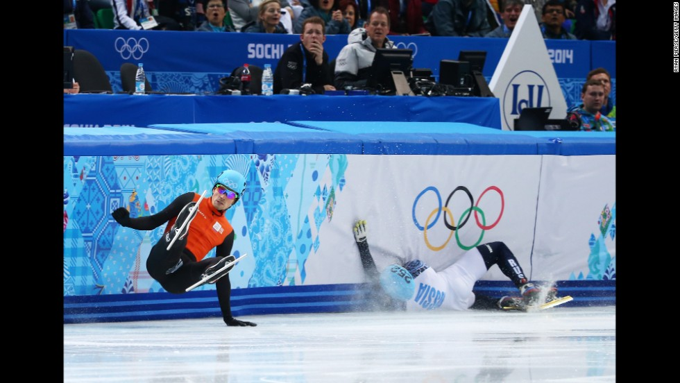 Short track speedskaters Freek van der Wart of the Netherlands, left, and Vladimir Grigorev of Russia fall to the ice in the 500-meter quarterfinals on February 21.