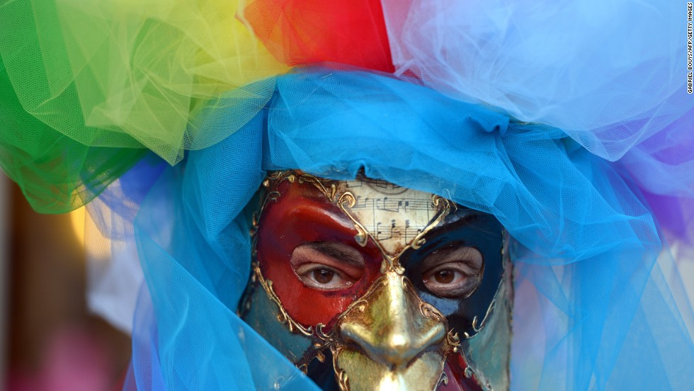 A costumed reveler poses near St. Mark's Square in Venice, Italy, during carnival celebrations on Friday, February 21.