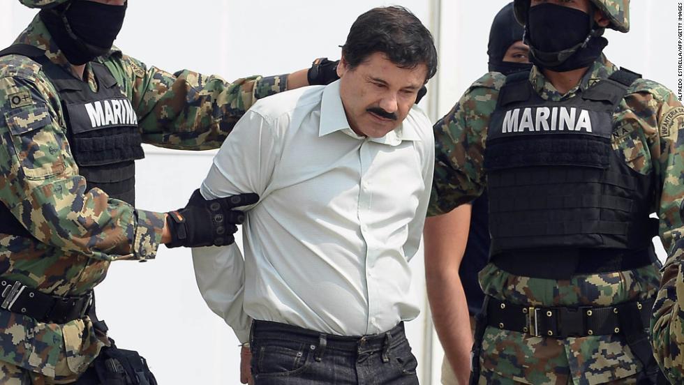 """Mexican drug trafficker Joaquin """"El Chapo"""" Guzman is escorted by ..."""
