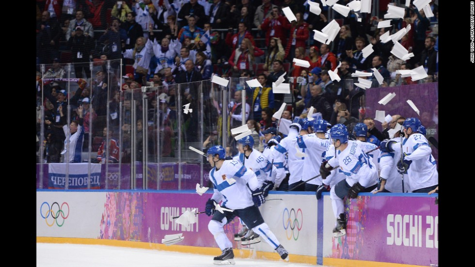 The Finnish men's hockey team celebrates a goal during the bronze medal game against the United States on February 22.