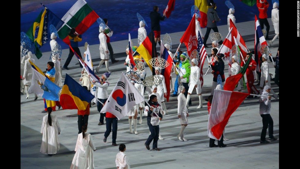 The flags of the competing nations enter the arena.