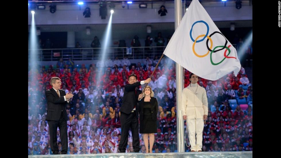 The Olympic flag is handed over to Lee Seok-rai, mayor of Pyeongchang.