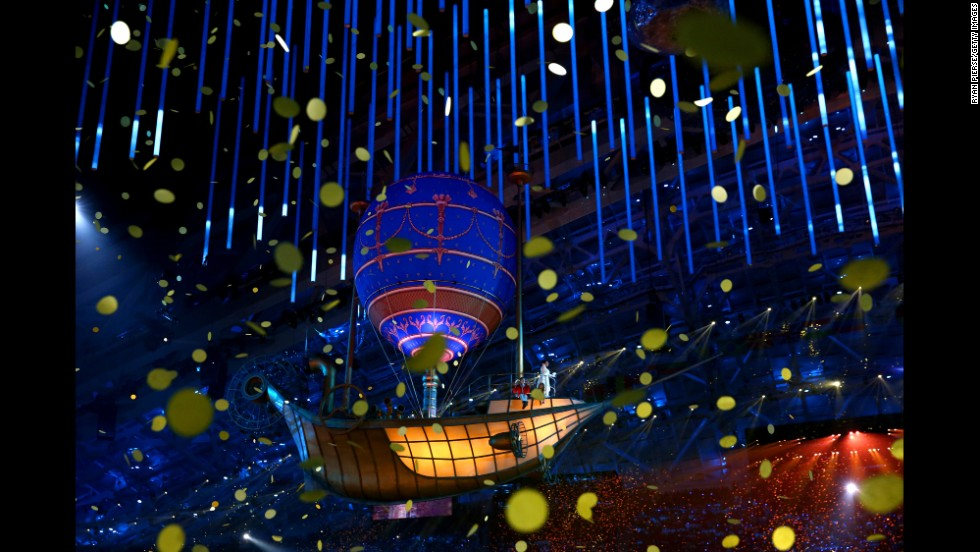 A balloon floats through falling confetti during the ceremony.