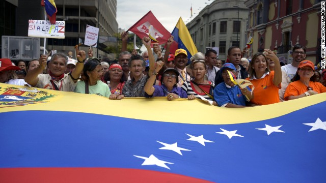 "Supporters of Venezuelan President Nicolas Maduro take part in the ""March of Seniors"" in Caracas on February 23, 2014. Hundreds of pro-government demonstrators, most of them seniors, marched Sunday in downtown Caracas in support of Maduro."