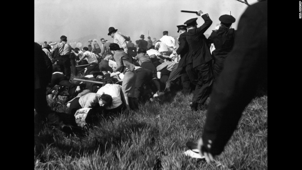 Armed with guns, clubs and tear gas, Chicago police put down a crowd of striking workers outside Chicago's Republic Steel plant on May 30, 1937. They killed 10 unarmed demonstrators and injured dozens in what was later called the Memorial Day Massacre. News cameras captured the brutality.