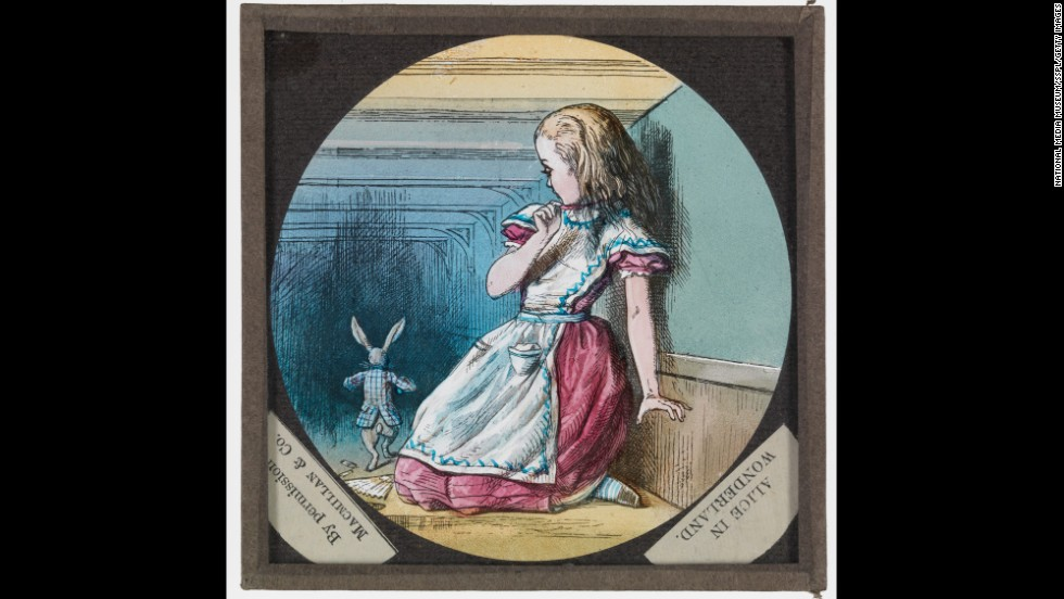 "Tenniel's illustrations were also used for slides for the magic lantern, an early form of projector. This slide show's a scene from ""Alice in Wonderland"" of Alice and the White Rabbit."