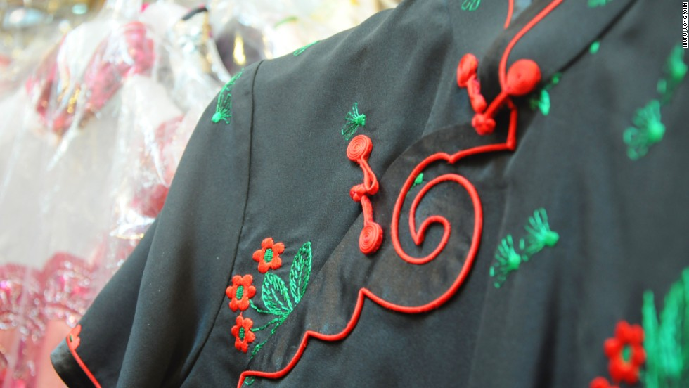 The main elements of the dress's original silhouette -- high collar, flower buttons on the placket -- make it easy to incorporate into new designs.