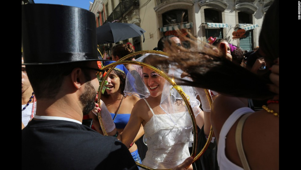 A reveler dressed as a bride holds giant wedding bands during carnival celebrations in Rio de Janeiro on February 23.